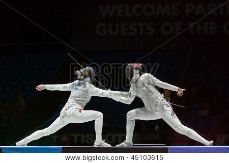 MOSCOW - APR 6: Beautiful fight on championship of world in fencing among juniors and cadets, in Sports complex, on April 6, 2012 in Moscow, Russia
