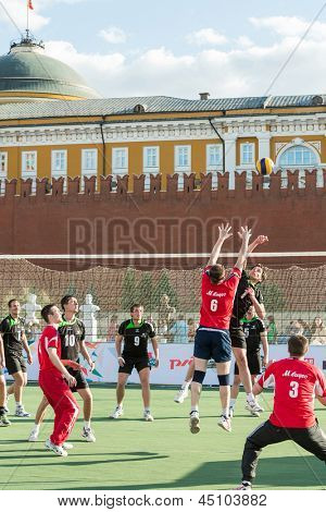 MOSCOW - MAY 26: Volleyball player tries to block the ball on VIII Forum Ready for Labor and Defense on May 26, 2012 in Red Square, Moscow, Russia.