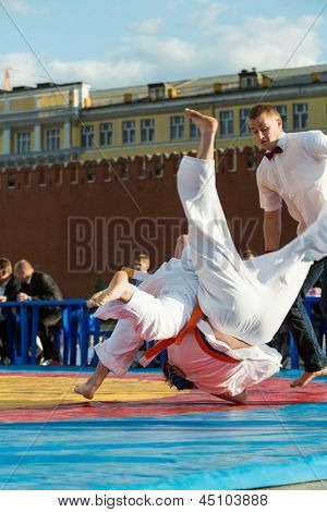 MOSCOW - MAY 26: Kudo fighter made throw on VIII Forum Ready for Labor and Defense on May 26, 2012 in Red Square, Moscow, Russia.