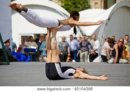 MOSCOW - MAY 27: Performance of yoga couple on Red Square during 8-th sports forum GTO, May 27, 2012, Moscow, Russia. More than 50 teams perform their sports program in forum.