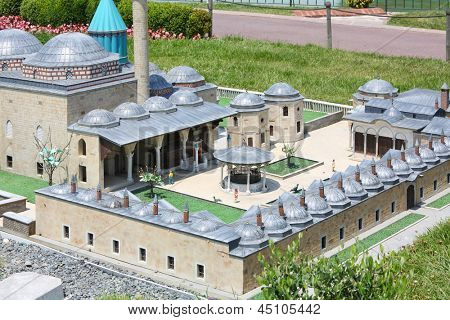ISTANBUL - JULY 4: Mevlana Tomb in Konya model and tourists in Miniaturk Museum, on July 4, 2012 in Istanbul, Turkey. Miniaturk Park was built in 2001-2003.