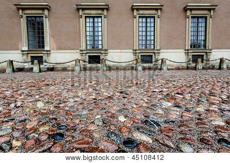 Wet Cobblestone And King Palace Facade In Gamla Stan (old Town) Of Stockholm, Sweden