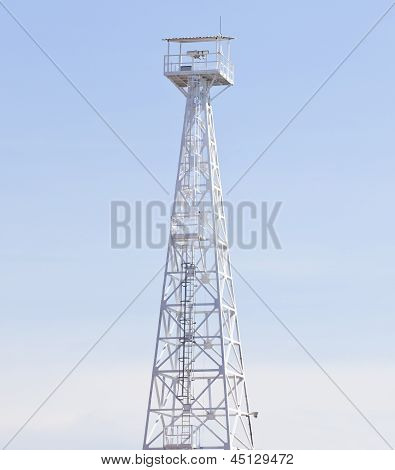 White Observation Tower And Blue Sky Background