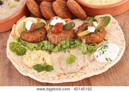 pita bread with falafel and sauce