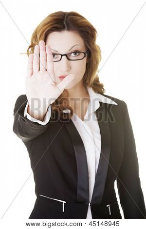 Serious business woman gesturing stop sign, isolated on white