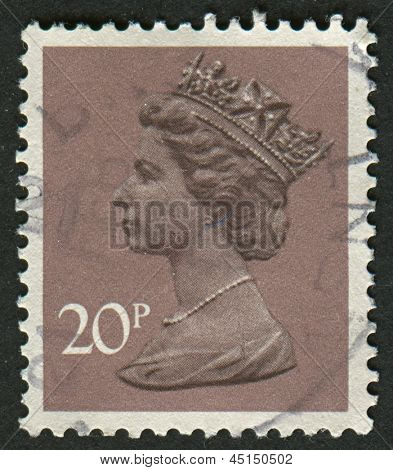 UK-CIRCA 1976:A stamp printed in UK shows image of Elizabeth II is the constitutional monarch of 16 sovereign states known as the Commonwealth realms, in Dull Purple, circa 1976.