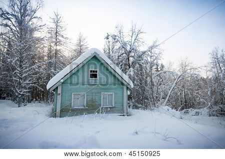 Wooden House In Snow-covered Russian Wood
