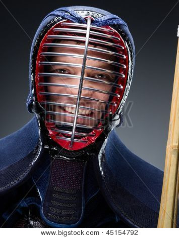 Portrait of kendoka with shinai. Concept of Japanese martial arts