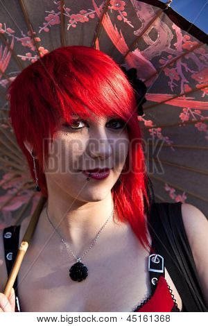Colorful Girl Made Up As Manga Girl And Poses For Photografers