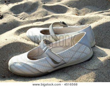 White Shoes In Sand