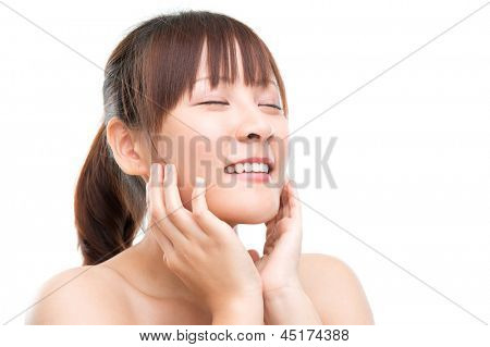 Asian girl skincare concept. Skin refreshing. Close up beautiful young woman face isolated on white.
