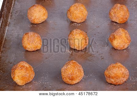 Balls of dough for snickerdoodle cookies on a pan ready to be baked poster