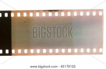 Old vintage film strip.Retro style. White isolated poster