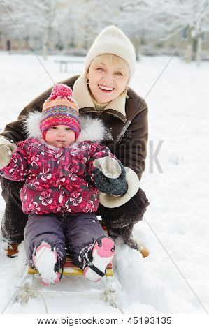 Winter Portrait Of Grandmother And Granddaughter