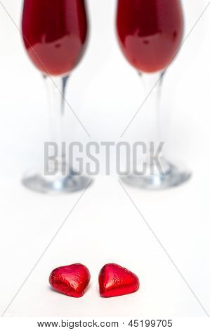 Candies And Two Glasses Of Wine