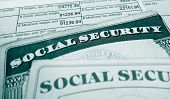 Closeup of Social Security cards and W2 wage form poster