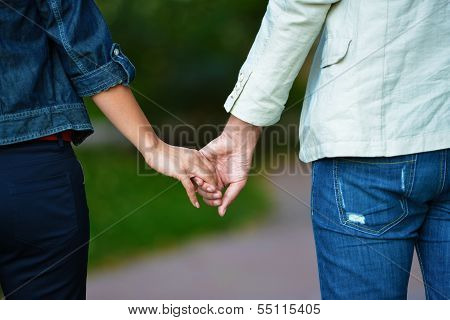 Lovely Couple Holding Hands