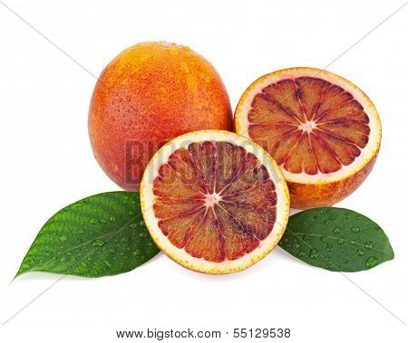 Ripe Red Blood Oranges With Cut And Green Leaves Isolated On White Background.