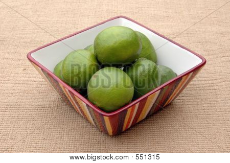 Limes In Striped Bowl