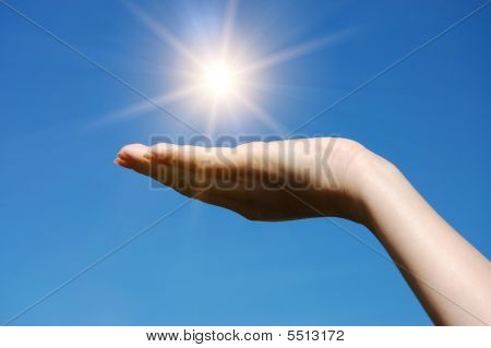 Hand Hold Against Blue Sky