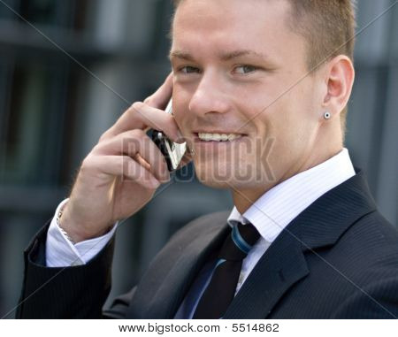 Smiling Corporate Man With Cell-phone
