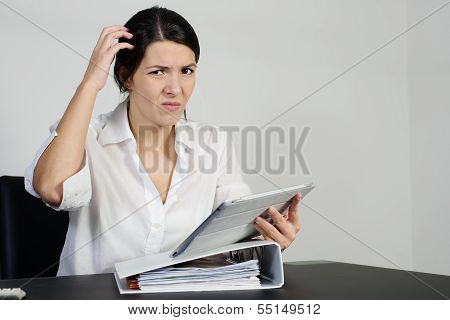 Puzzled Woman Scratching Her Head