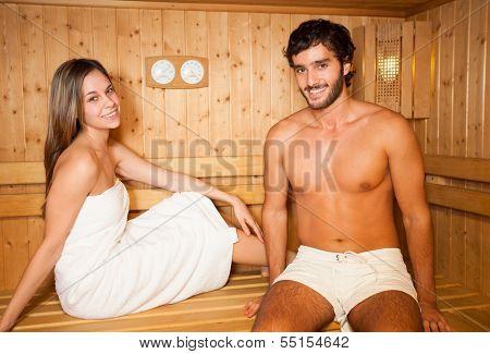 Couple having a sauna bath in a steam room