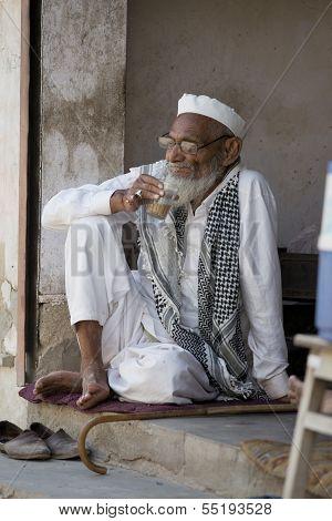 Indian Shopkeeper Relaxing