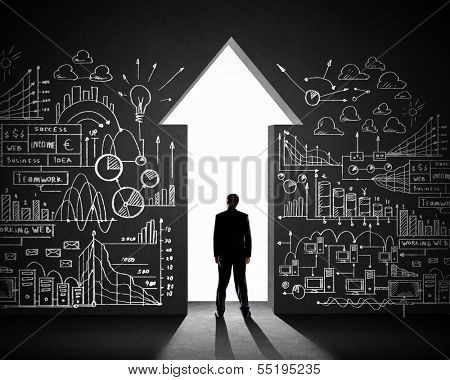 Silhouette of businessman against black wall. Business direction poster