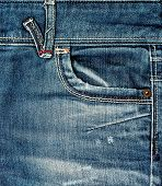 Jeans background.Close-up blue denim with pocket . poster