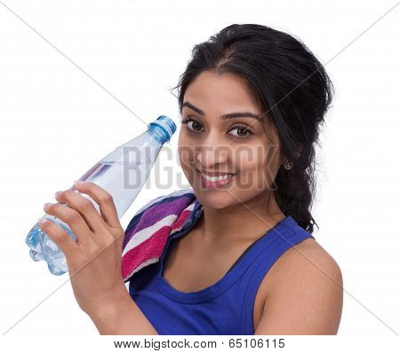 Smiling female athelte with water bottle