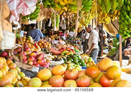 NAIROBI, KENYA- FEBRUARY 6, 2014: Ripe fruits stacked at a local fruit and vegetable market on February 6, 2014. Nairobi, Kenya. The market is frequently visited by locals and tourists.