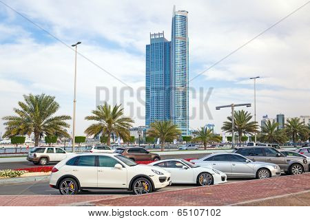 ABU DHABI, UAE - MARCH 29: Luxury cars on the street of Abu Dhabi on March 29, 2014, UAE. Abu Dhabi is one of the richest cities in the world with many luxury cars on the street.