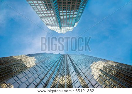 Two skyscrappers rise proud over a blue sky in Toronto city poster