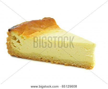 A triangle slice of plain cheese cake