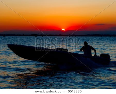 Sanset In Venice. Motor Boat And Human Silhouette
