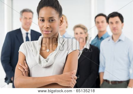 Confident African Businesswoman In Front Of Office Staff poster