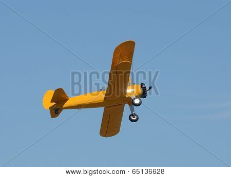 Old Yellow Biplane In Flight