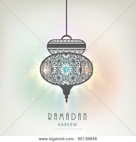 Beautiful floral decorate arabic lamp or lantern on colourful background, creative greeting card design for holy month of Ramadan Kareem.