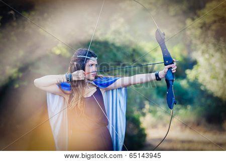 elven wood princess shooting bow and arrow
