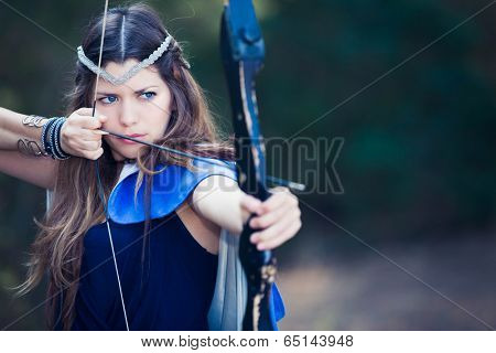 fictional forest hunter girl with bow and arrow
