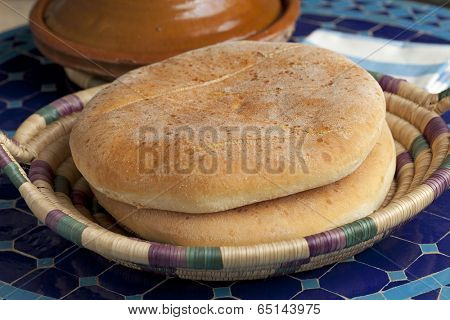 Moroccan bread and tagine on the table