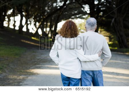 Couple Looking Down Path