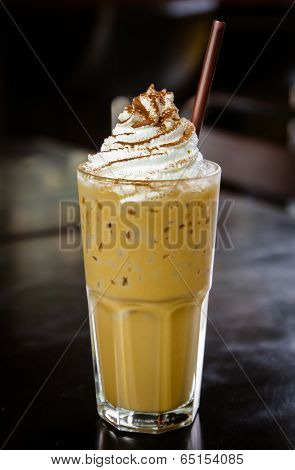 Iced Coffee With Whipped Cream On The Table.