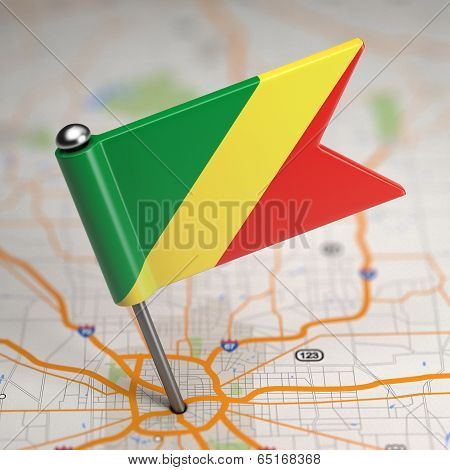 Republik of the Congo Small Flag on a Map Background.