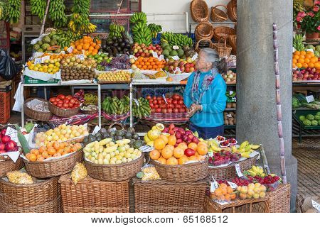 Woman Selling Vegetables At The Market Of Funchal, Madeira Island
