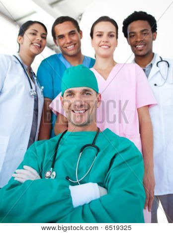 International Medical Team With A Confident Surgeon In The Foreground