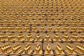 Million golden Buddha figurine in Wat Phra Dhammakaya. Buddhist temple in Bangkok Thailand.Maha Dhammakaya Cetiya poster