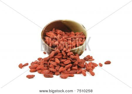 Goji Berries Spilling From Dish