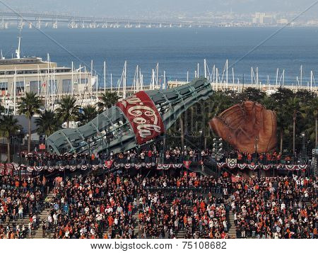 Fans Standing With Hands On Hearts In Bleacher Section With Large Glove And Giant Coca-cola Slide Du